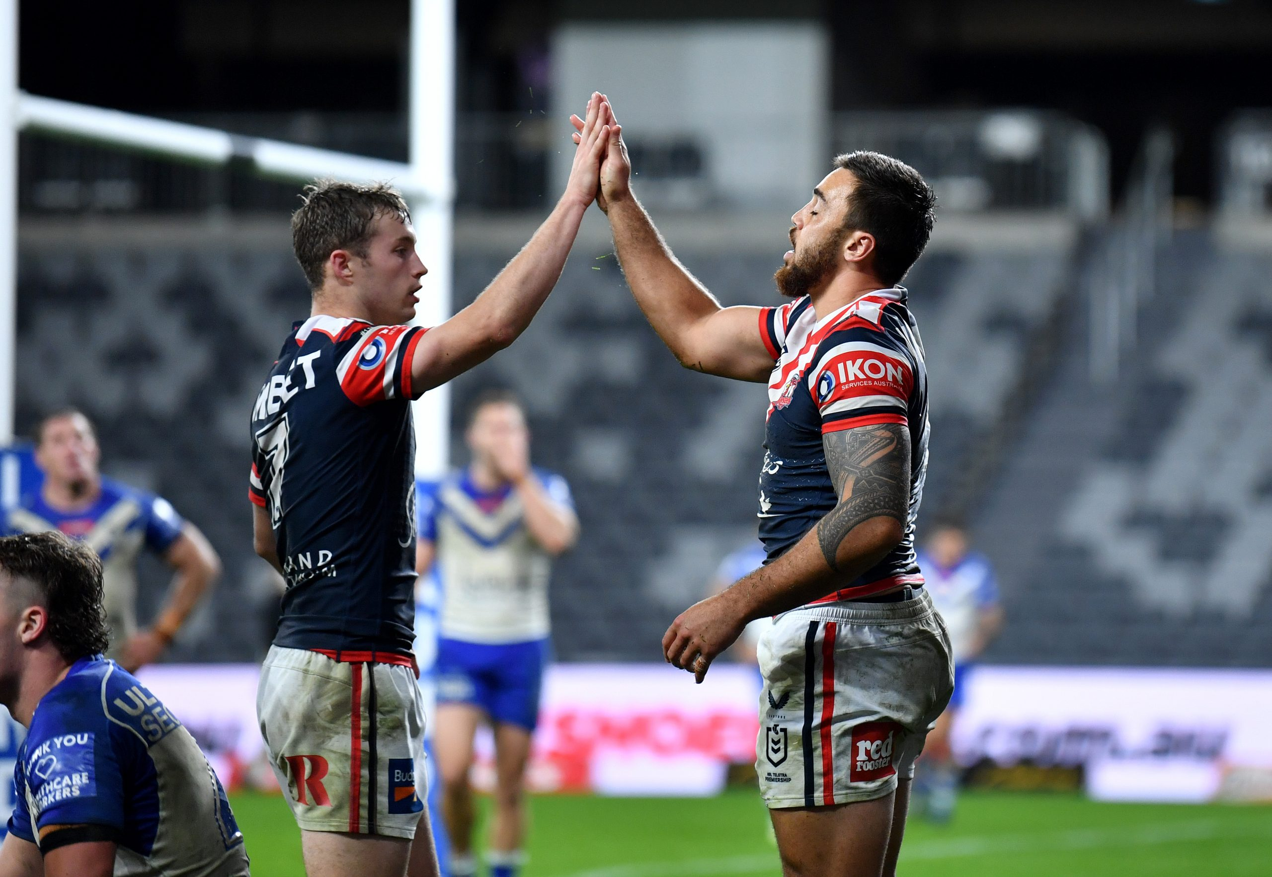 Walker stands up as Roosters defy brave Bulldogs